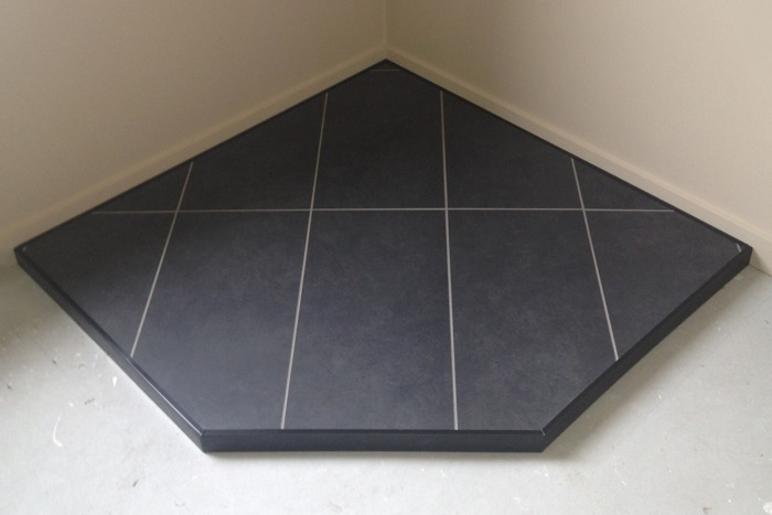 Custom tile, corner hearth, black metal trim