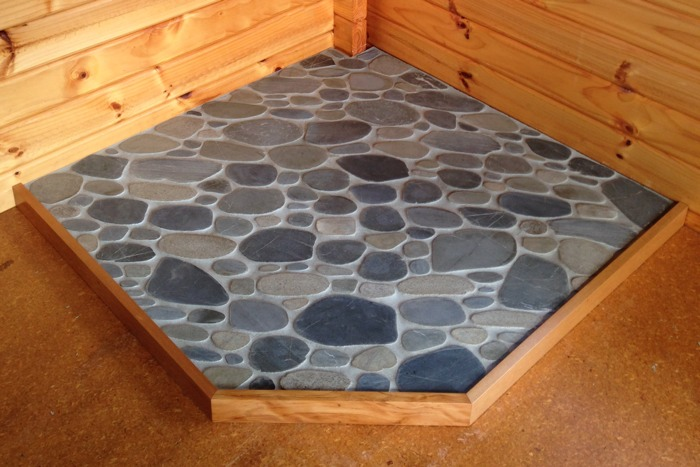 Riverstone, corner hearth, rimu trim